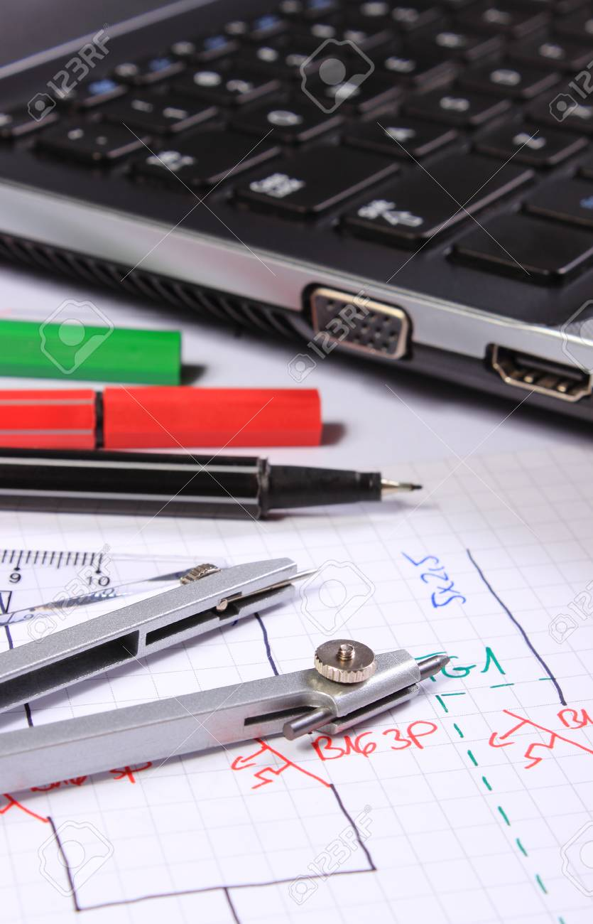 electrical diagrams, accessories for drawing and laptop, drawings and  accessories for the projects engineer