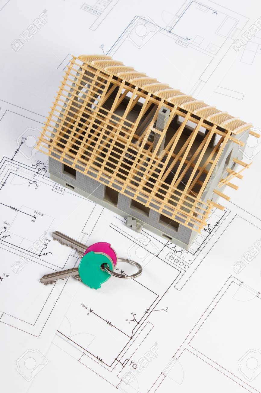 Home Keys And Small House Under Construction Lying On Electrical ...