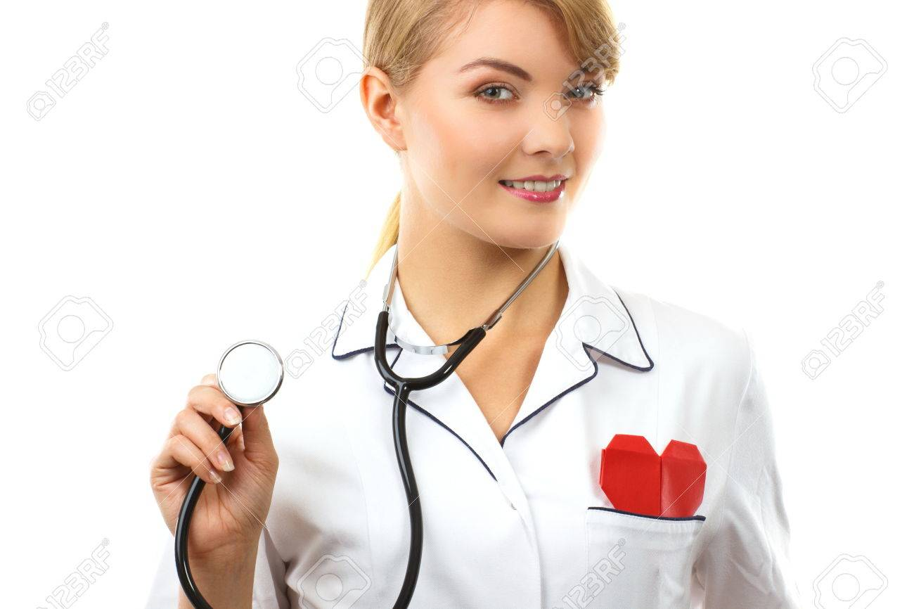 White apron health - Smiling Woman Doctor Cardiologist In White Apron With Stethoscope And Red Heart Of Paper Healthcare