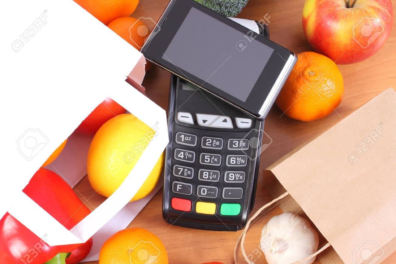 credit card reader payment terminal with mobile phone with nfc technology and fresh fruits and - Credit Card Swiper For Phone