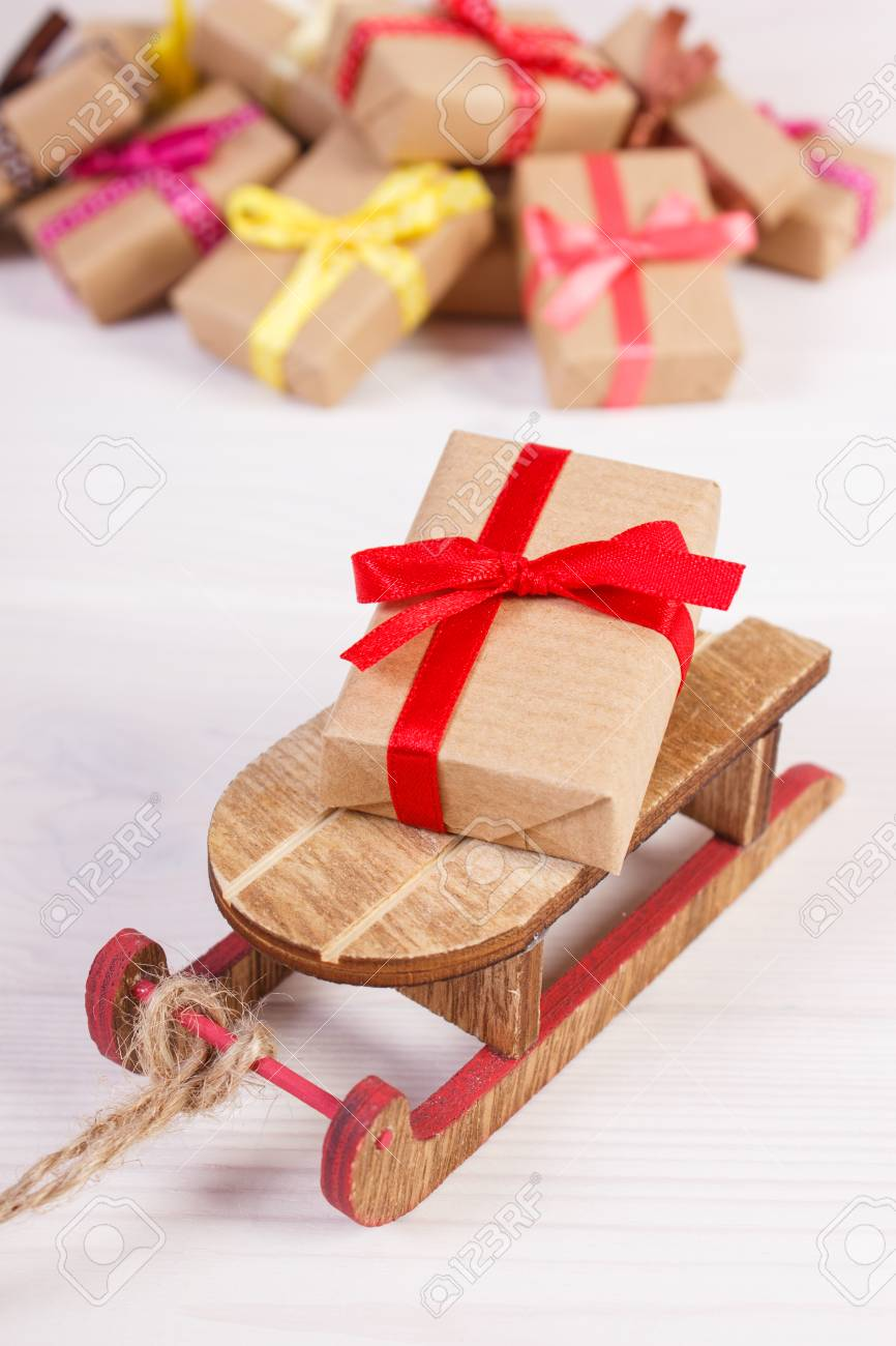 Wooden Sled And Wrapped Gifts With Ribbons For Christmas Valentine