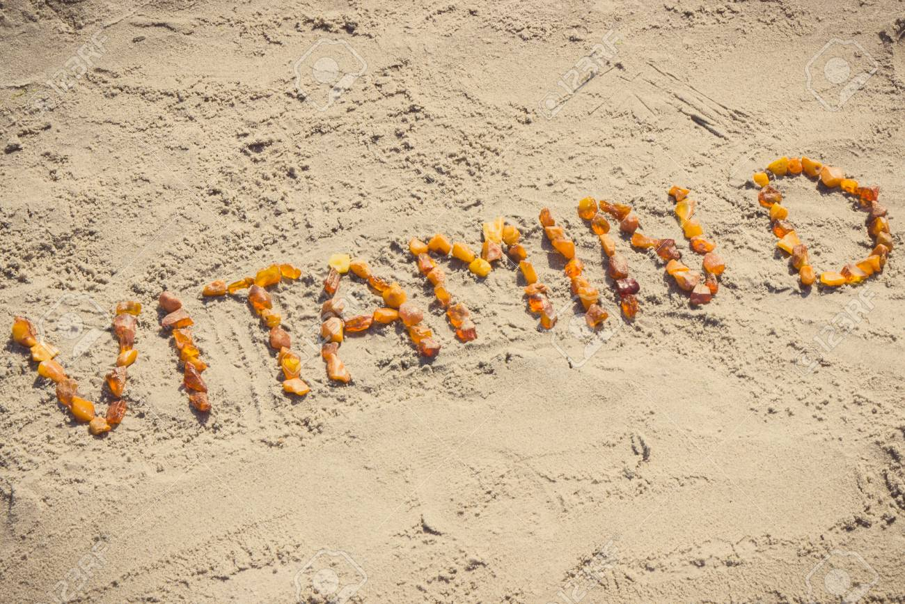 Vintage photo, Inscription vitamin D made of amber stones on sand at beach, concept of vacation time, healthy lifestyle and prevention of vitamin D deficiency - 96666306