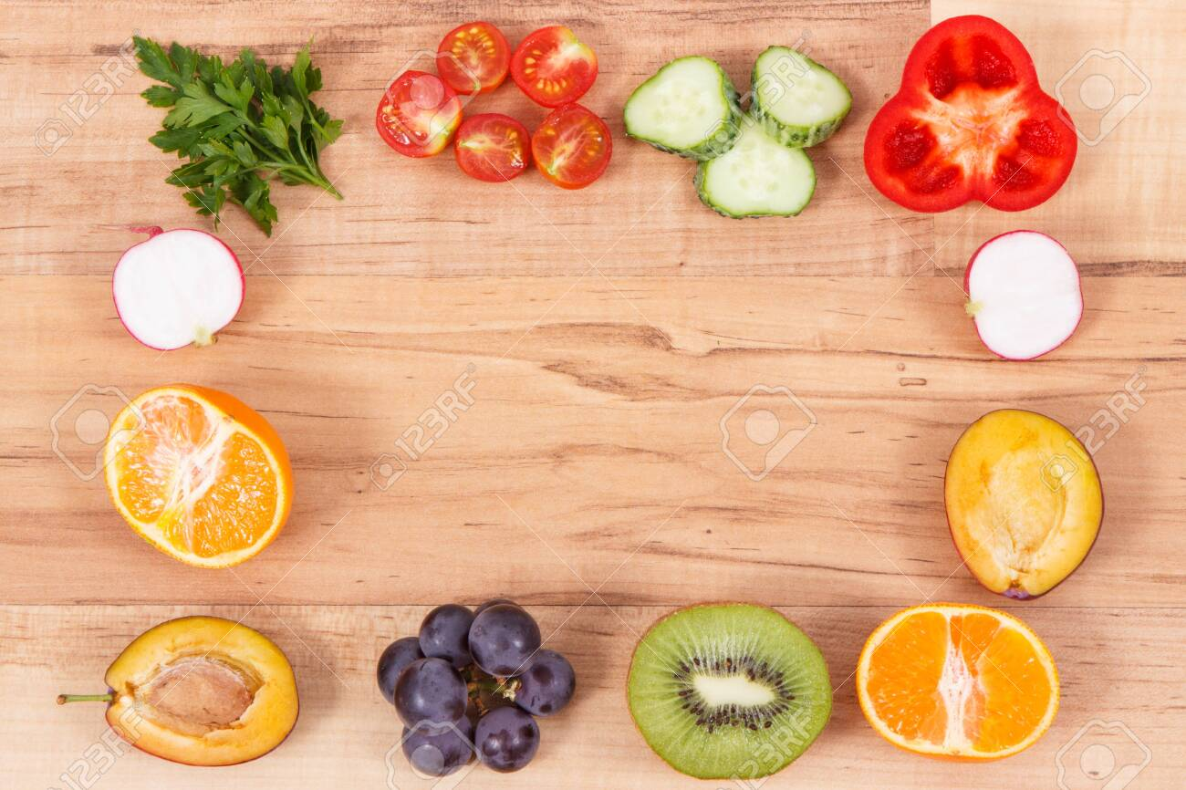 Frame of fresh healthy nutritious fruits and vegetables as source vitamins, dietary fiber and minerals, place for text or inscription - 132080101