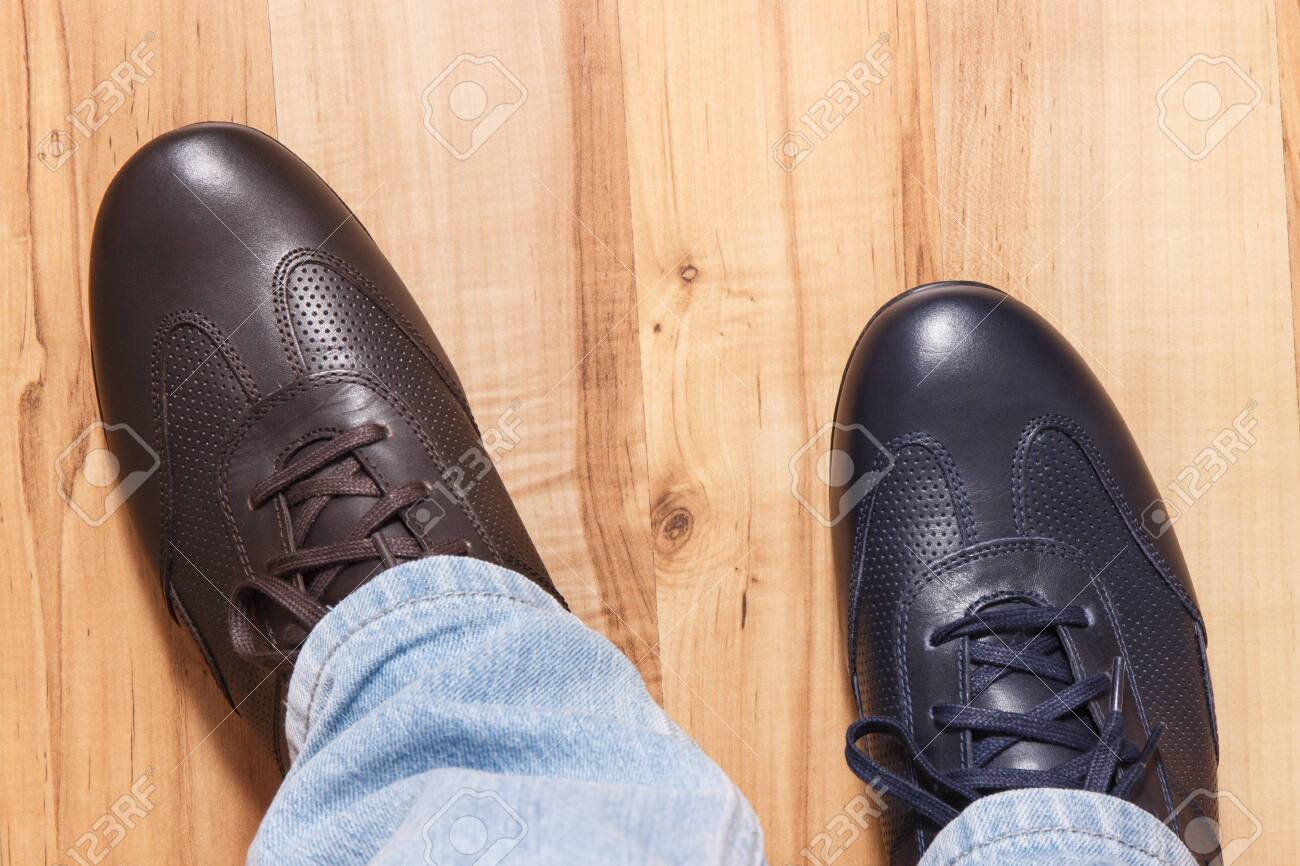 Elegant stylish comfortable navy blue and brown shoes for men on board - 145335401