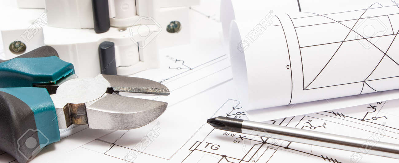 Work tools, electric fuse and diagrams of plan with electrical installation. Building home concept - 168772096