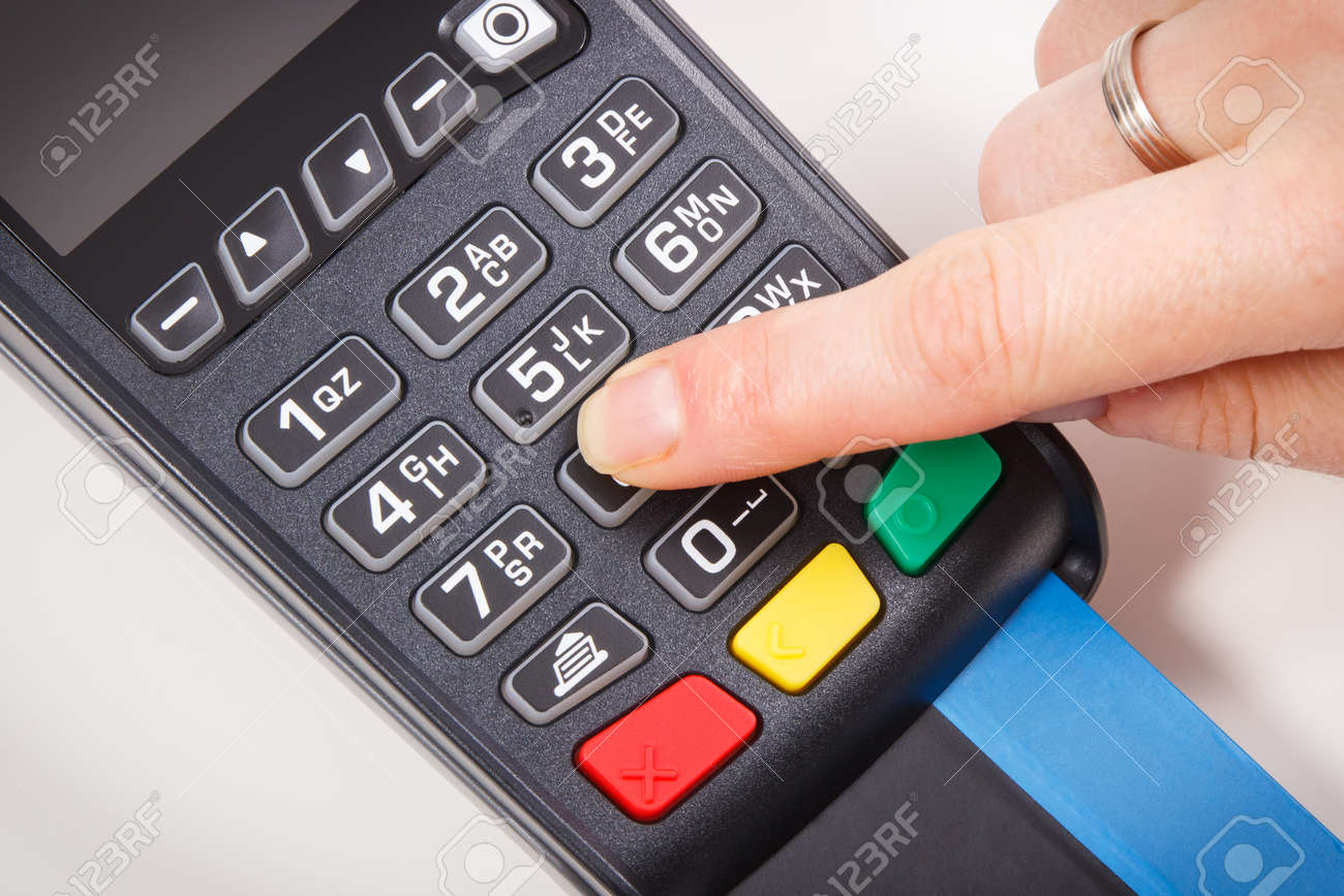 Payment terminal and finger entering PIN code. Credit card reader using for cashless paying. Finance concept - 168775702