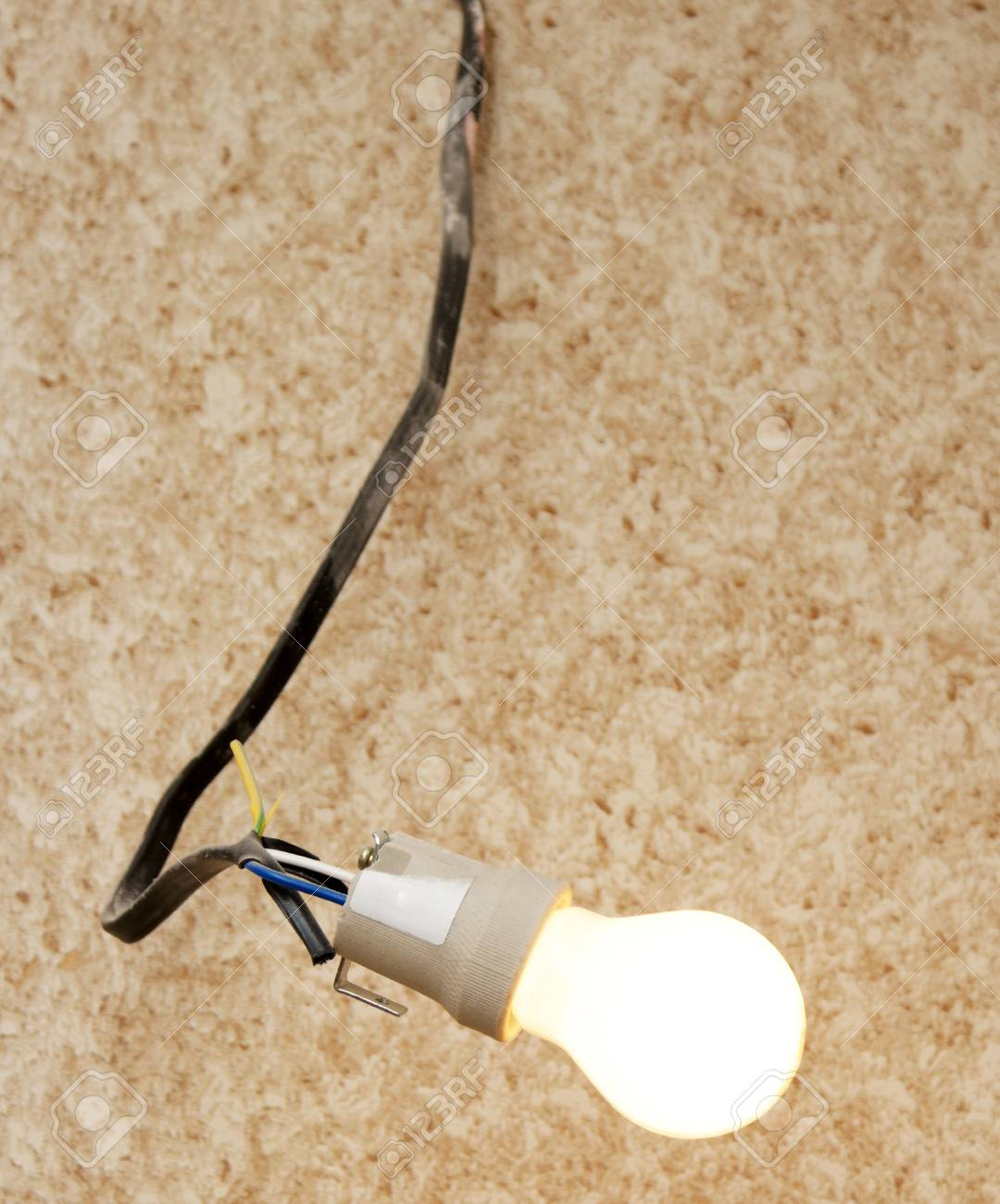 Shining electric bulb against a wall Stock Photo - 6536901