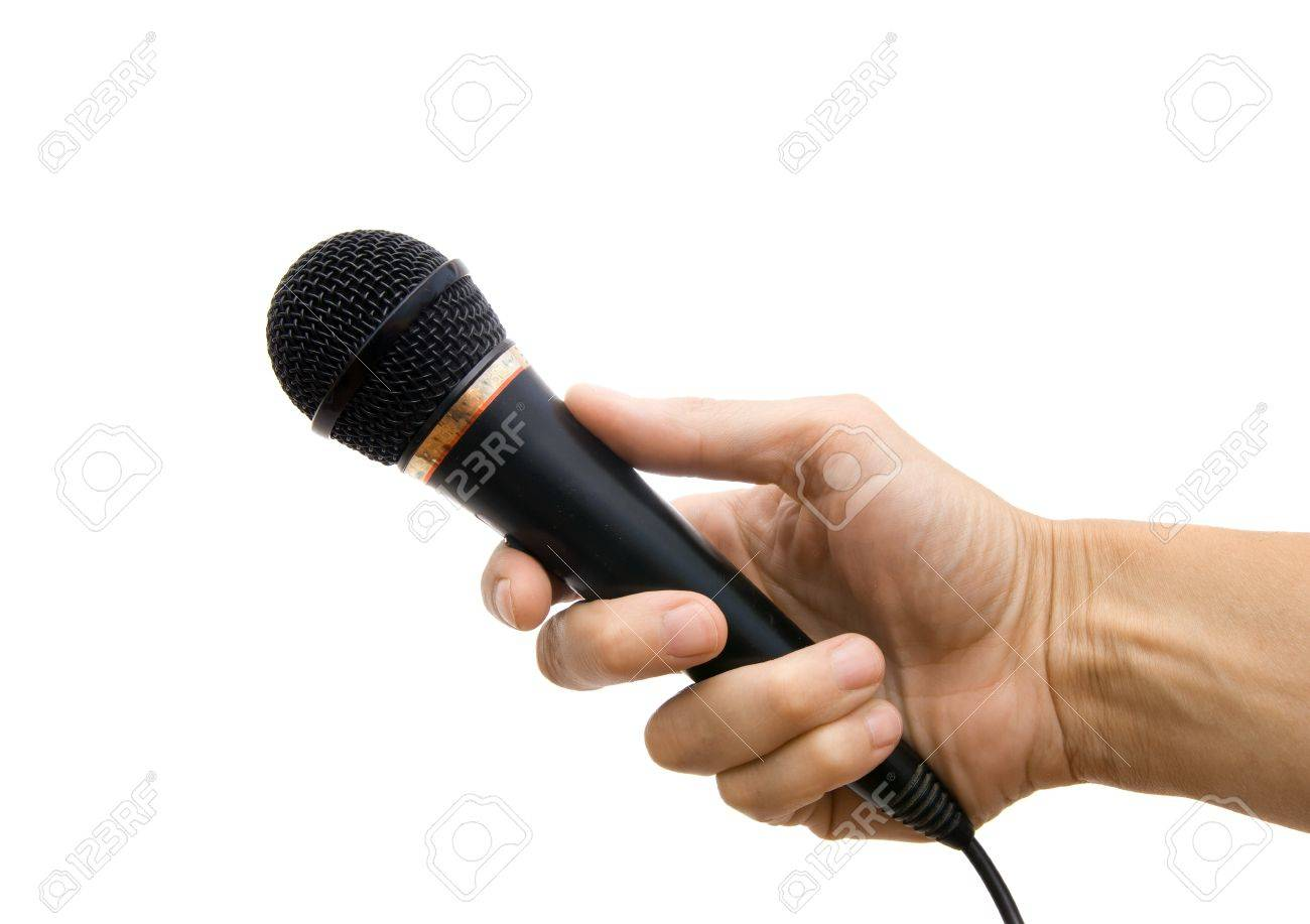 Microphone in a hand on a white background Stock Photo - 7308223