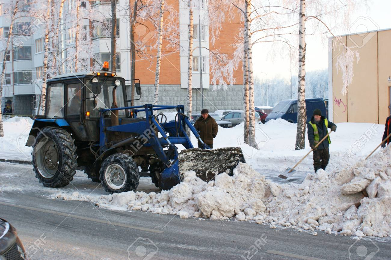 RUSSIA, MOSCOW - JAN 11: People and technics clean snow from street