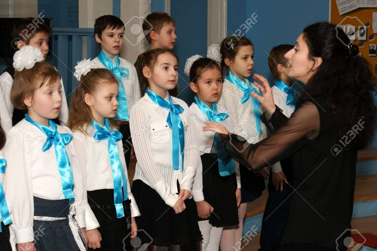 The chorus of girls participates in musical competition at music school in area Butyrsky in Moscow Stock Photo - 10484136