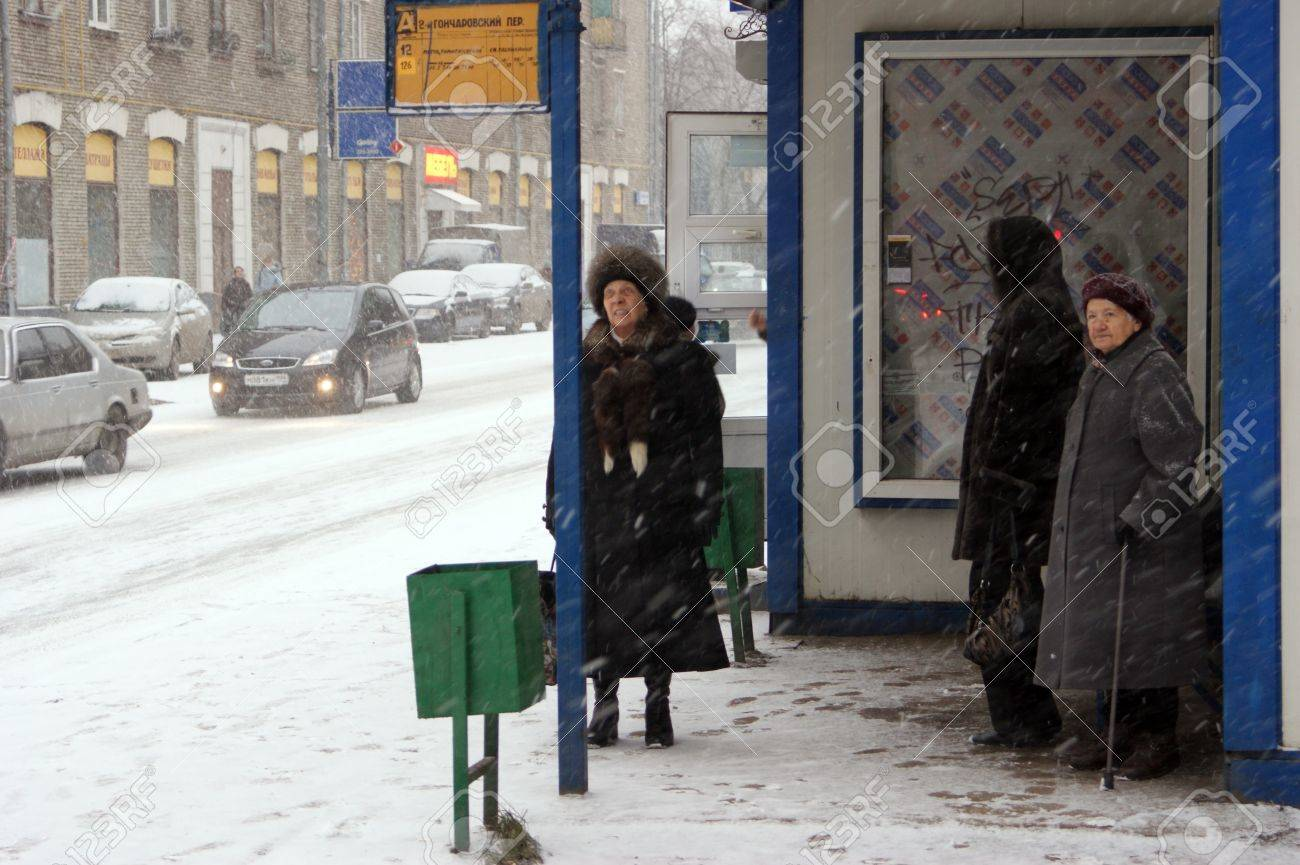 People wait the bus at a snow covered stop Stock Photo - 10559189