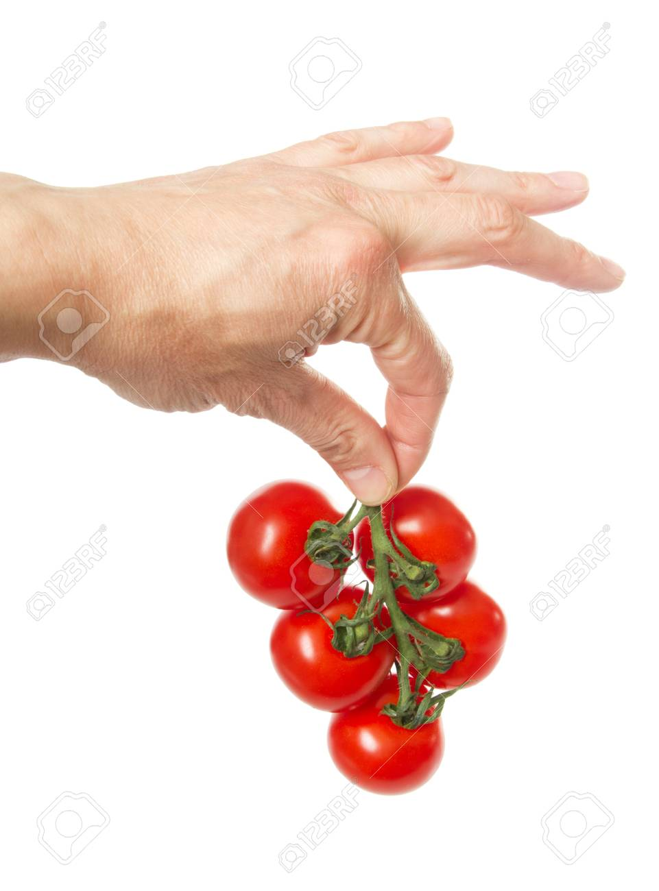 red tomatoes in a dark plastic box, it is isolated on the white Stock Photo - 12850126