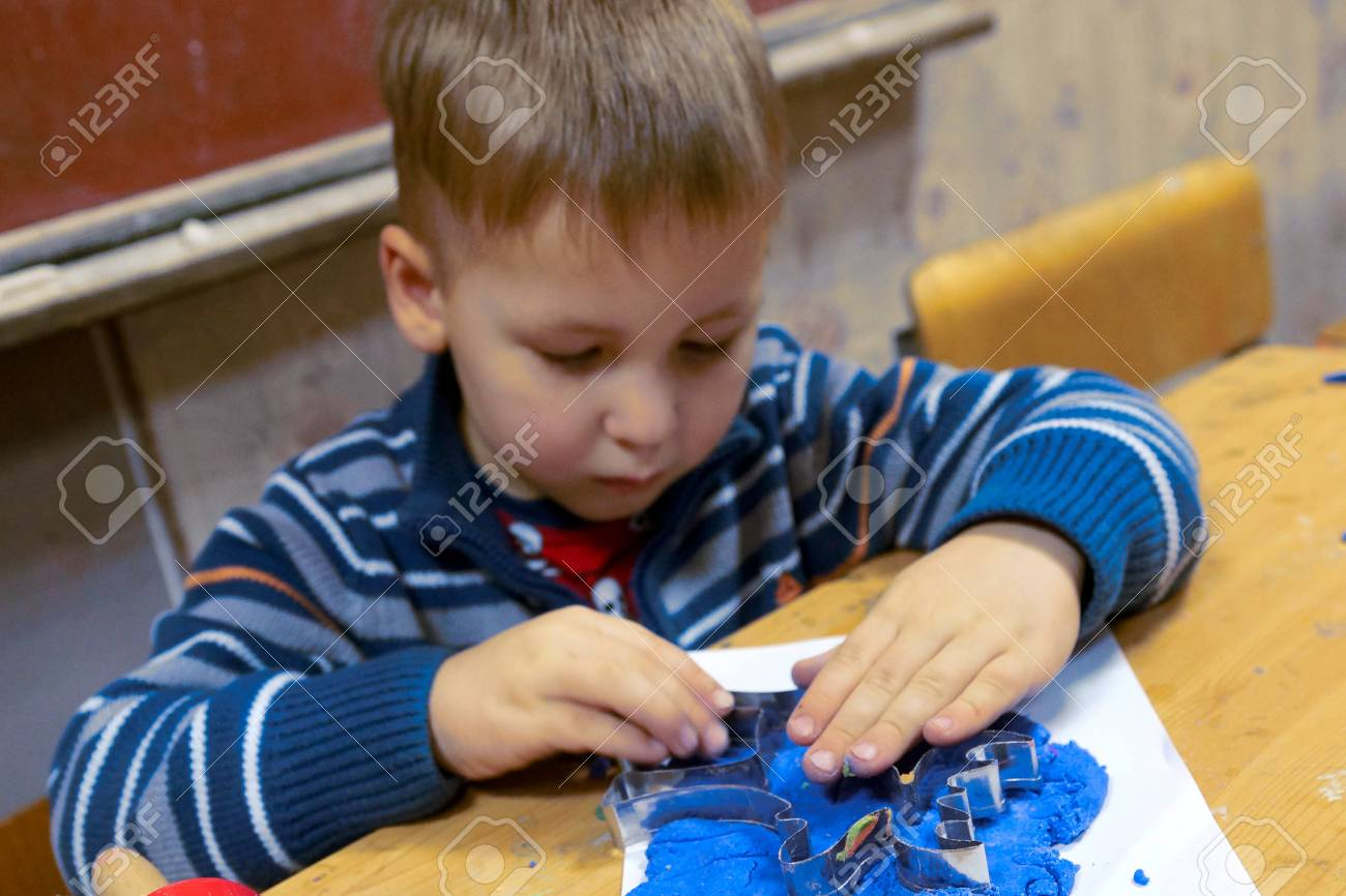 07.12.2012 Moscow. Occupations in the creativity house, the Child molds from plasticine Stock Photo - 16978918