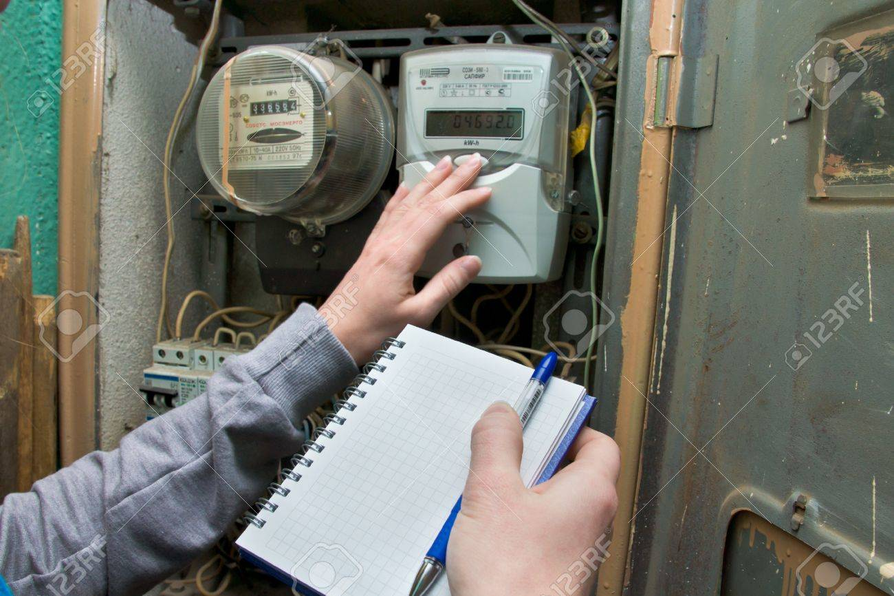 21 01 2013 Moscow. Write down indications of the multitariff electric meter. Stock Photo - 18368480