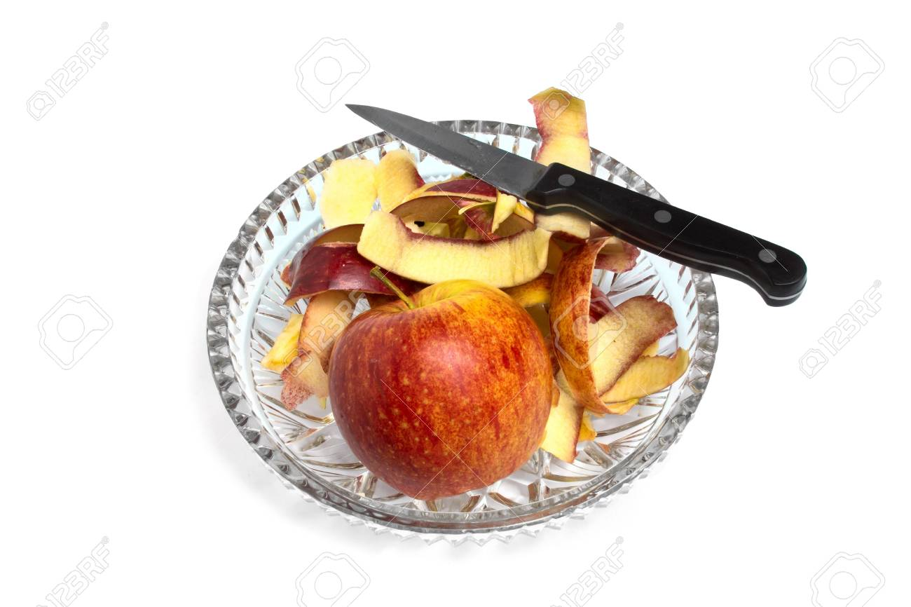 apple and a knife on a crystal plate Stock Photo - 18625037
