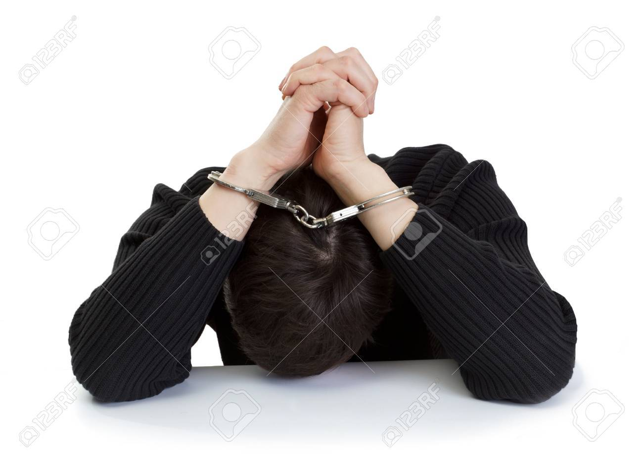 The man in handcuffs closes hands the head Stock Photo - 18666445