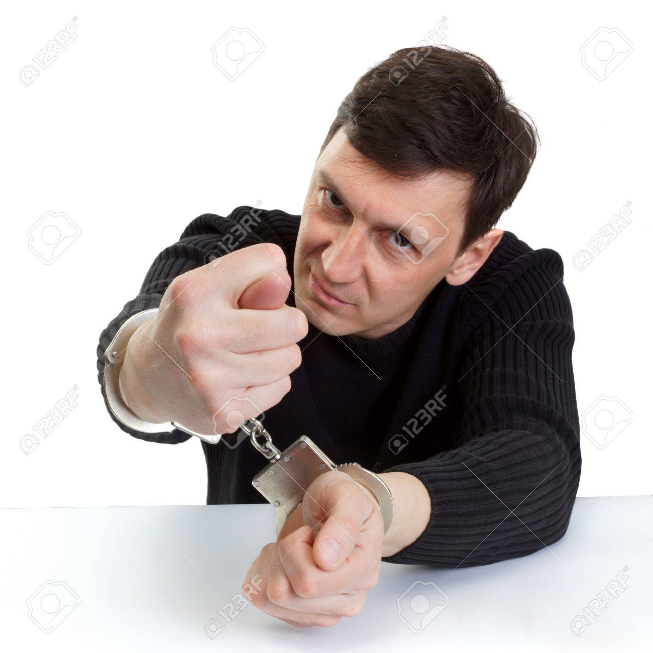The man in handcuffs shows a fig. Stock Photo - 19203518