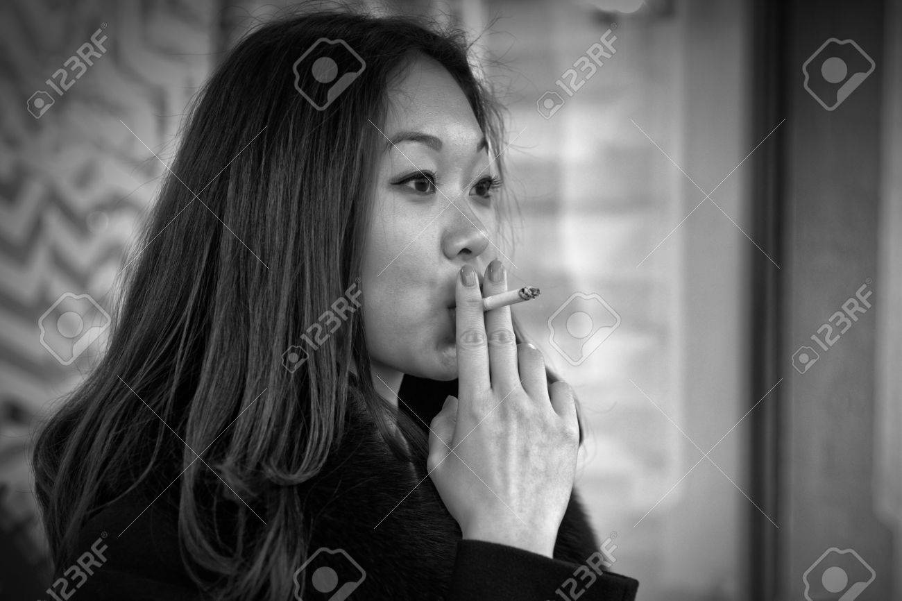 https://previews.123rf.com/images/ratru/ratru1503/ratru150300004/37191169-black-and-white-photo-of-an-asian-woman-smoking-in-real-life-.jpg