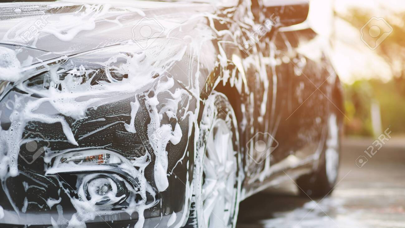 Outdoor car wash with active foam soap. commercial cleaning washing service concept. - 128219925