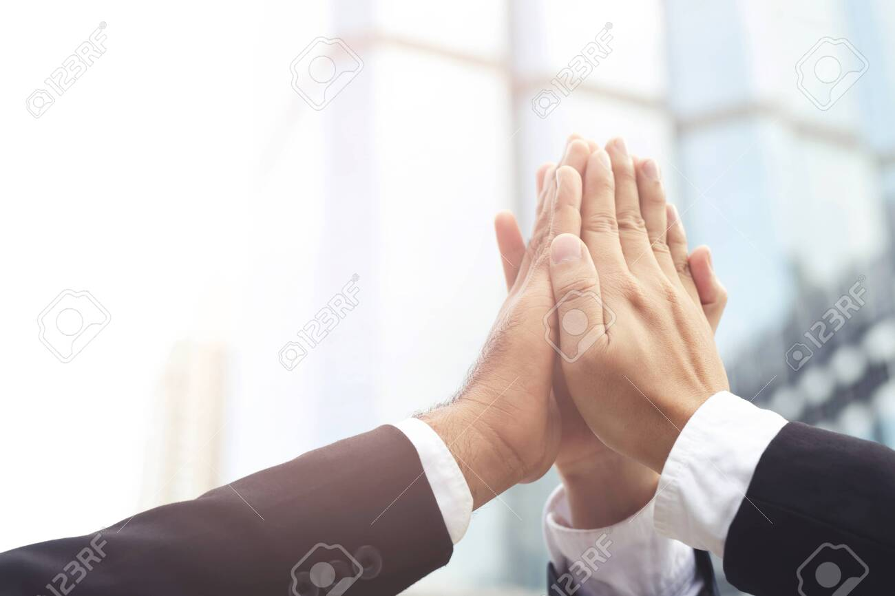 Give me five your clap hands articulate group businessman for good business team. concept Success and encouragement to overcome and overcame obstacles business solution strategy. - 131673831