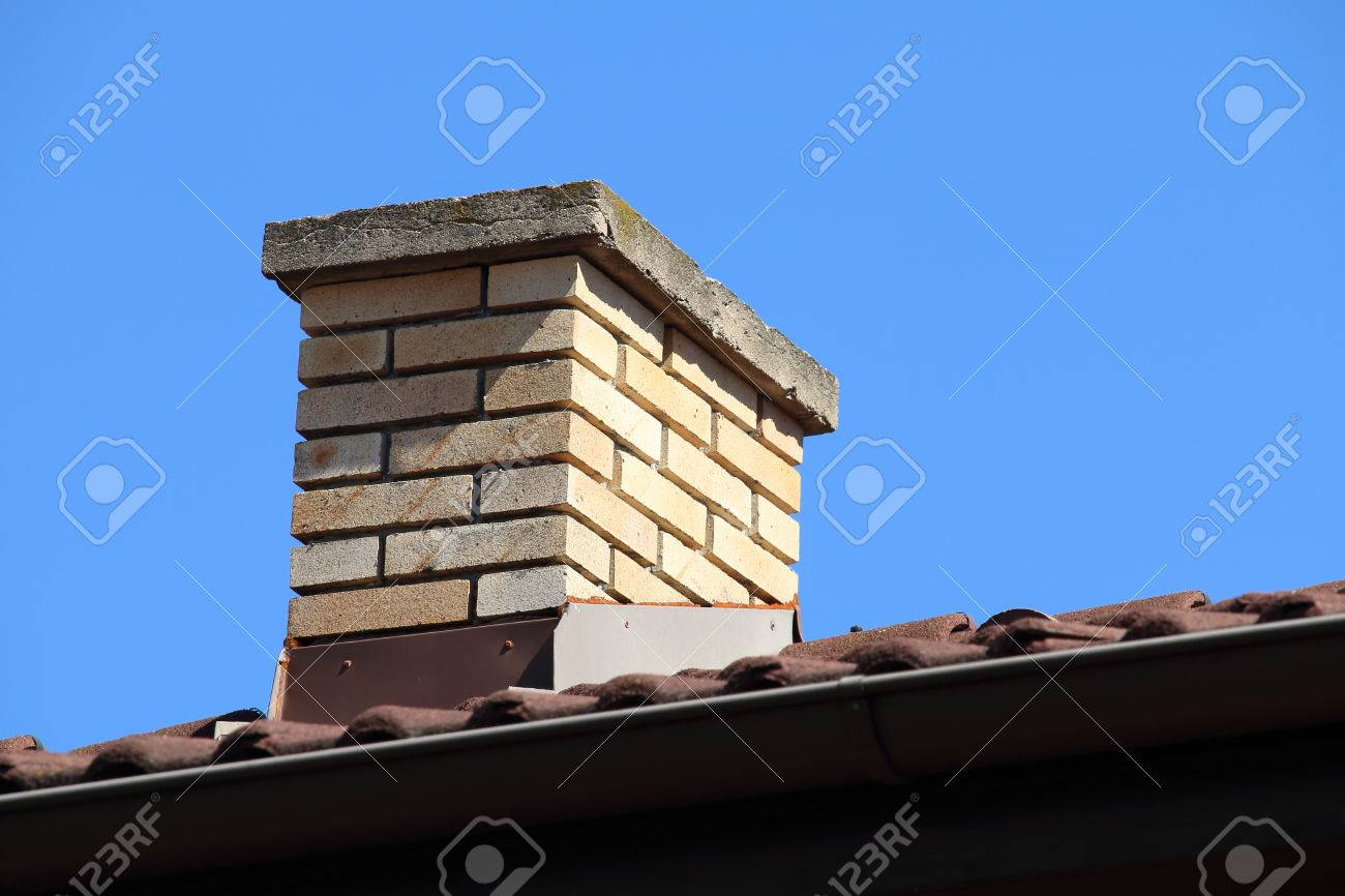 roof detail of a detached house with red roof tile and beige stock