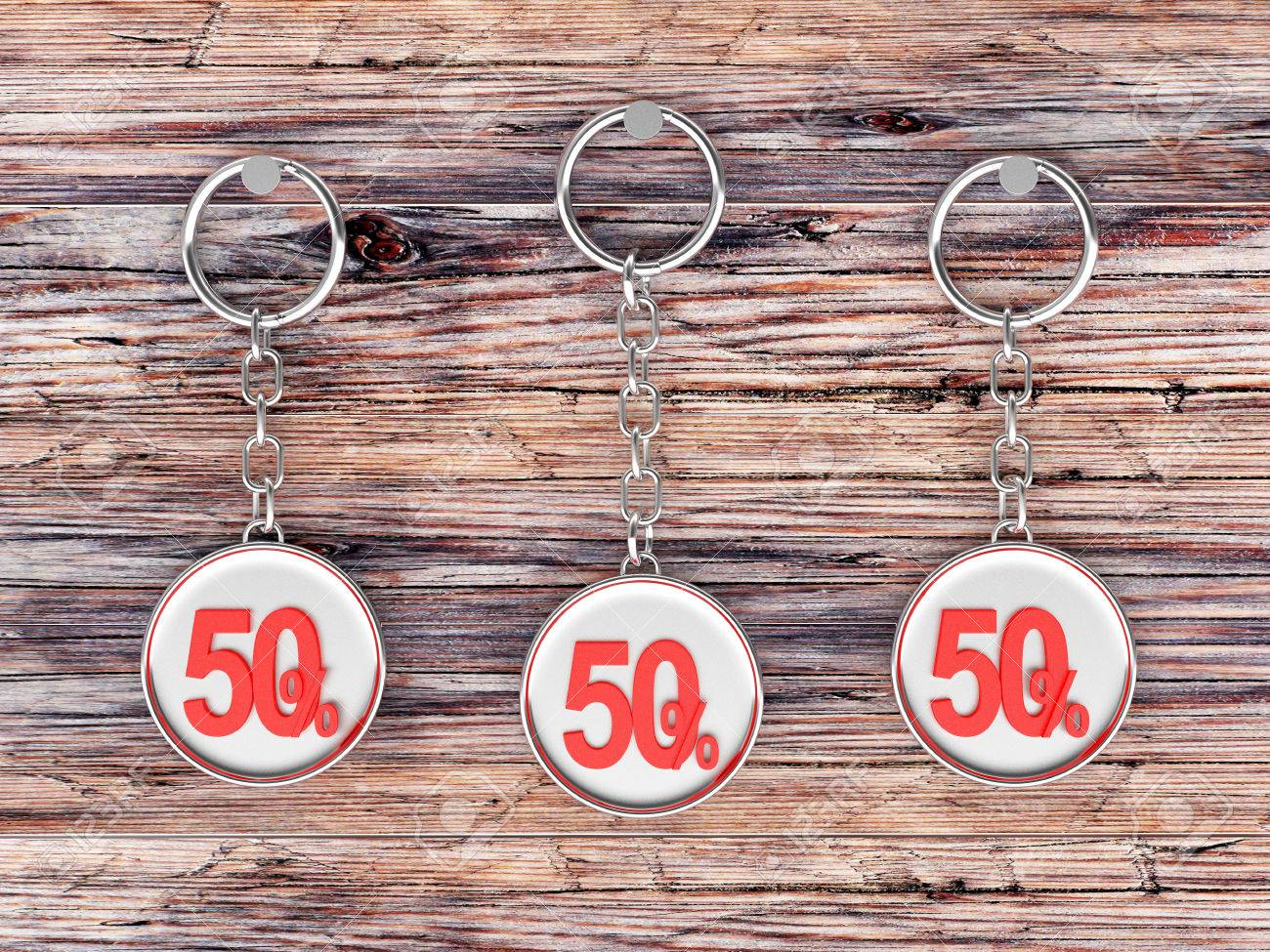 Illustration - Set of three silver keychains with red 50 percentage discount  on wooden background. 3D illustration 98797cf01682