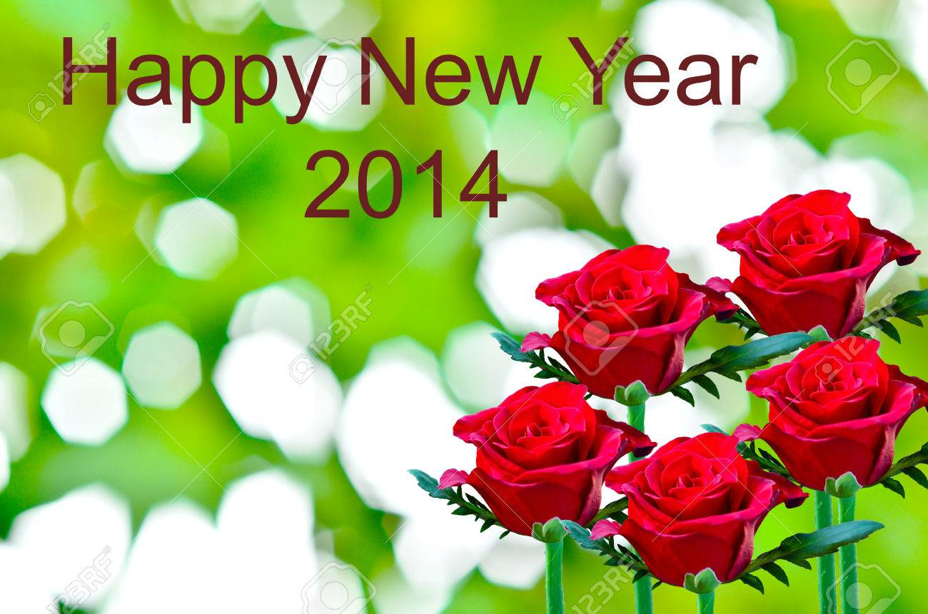 beautiful red rose write happy new year on green bokeh stock photo 23124234
