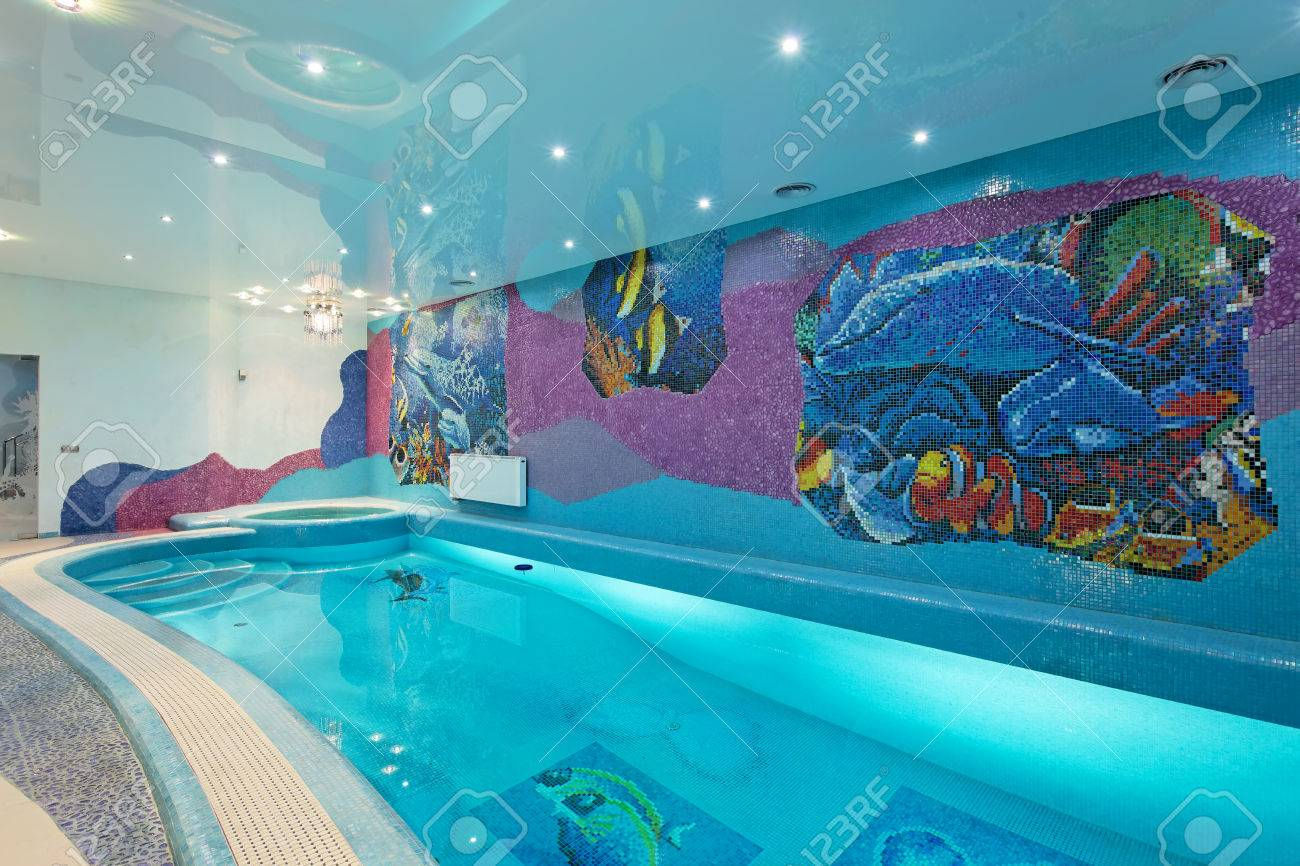Spa swimming pool design with mosaic fish on the wall and blue..