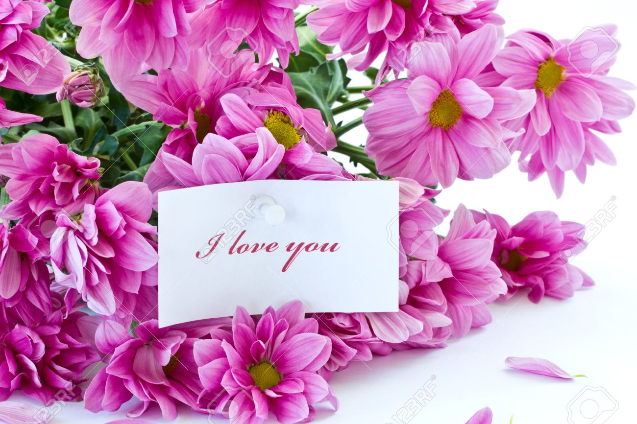 Says I Love You On A Background Of Beautiful Flowers Stock Photo