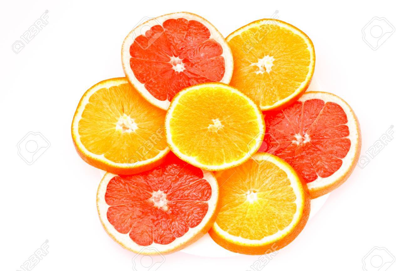 grapefruit and orange slices cut into isolated on a white background Stock Photo - 11067765
