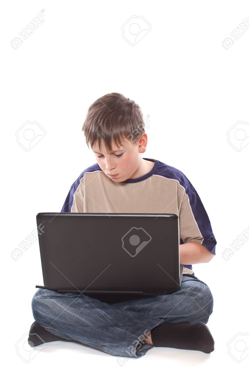 teenage boy with a laptop on a white background Stock Photo - 17505722