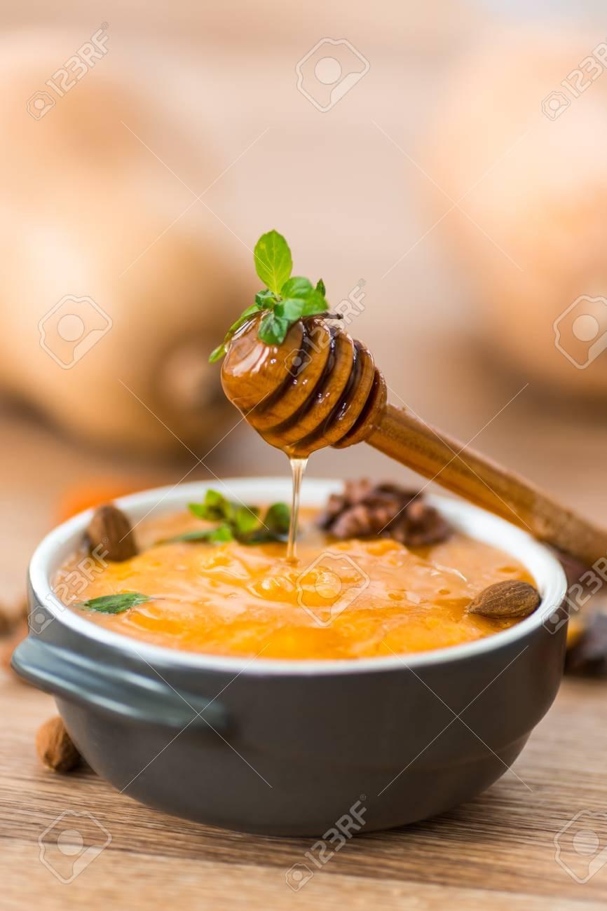 pumpkin porridge with walnuts, almonds and honey Stock Photo - 21958036