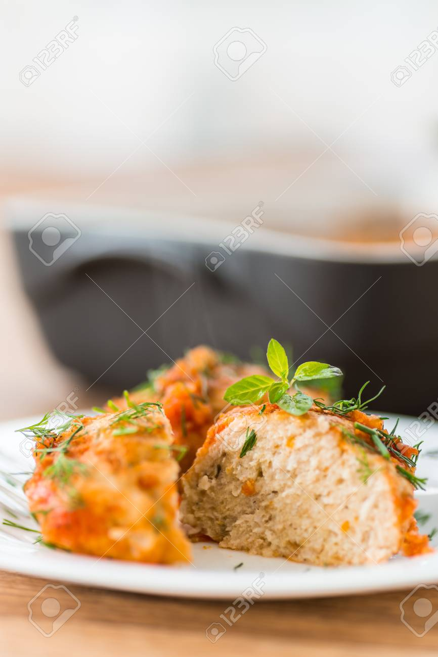 steamed chicken meatballs in tomato sauce with dill Stock Photo - 21958193