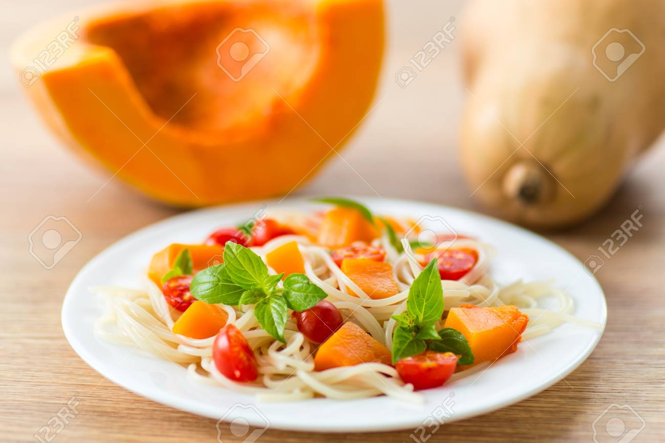 spaghetti with chunks of pumpkin and tomatoes Stock Photo - 21901567