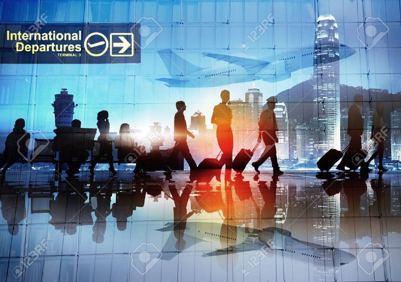 Silhouettes of Business People Walking in an Airport - 28862794