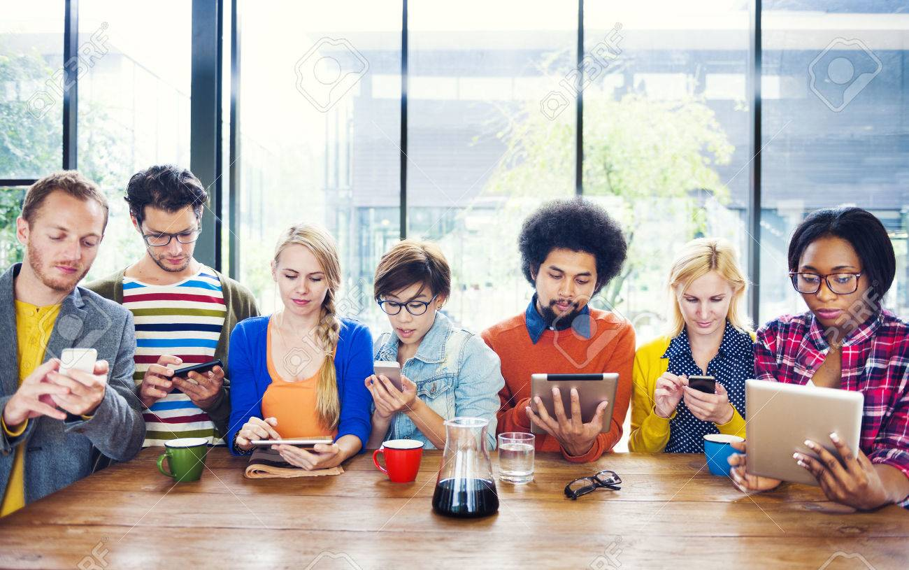 Multiethnic Group of People Socail Networking at Cafe Stock Photo - 28863322