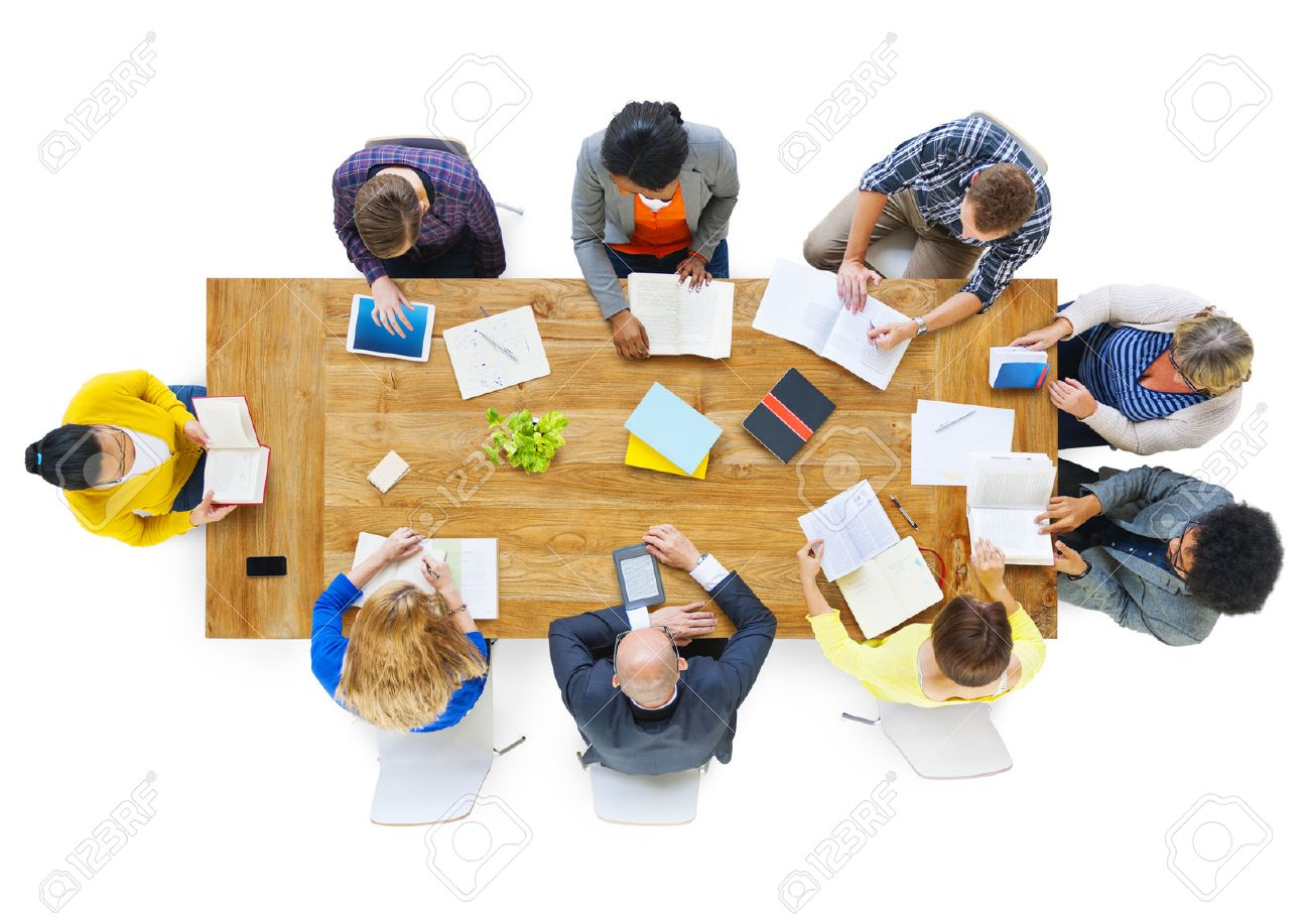 Group of Busienss People Reading Notes on a Meeting Table - 28864055
