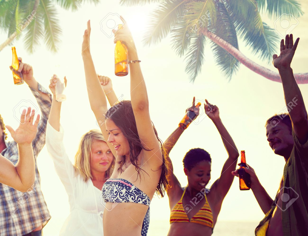 Group Of Cheerful People Partying On A Beach Stock Photo