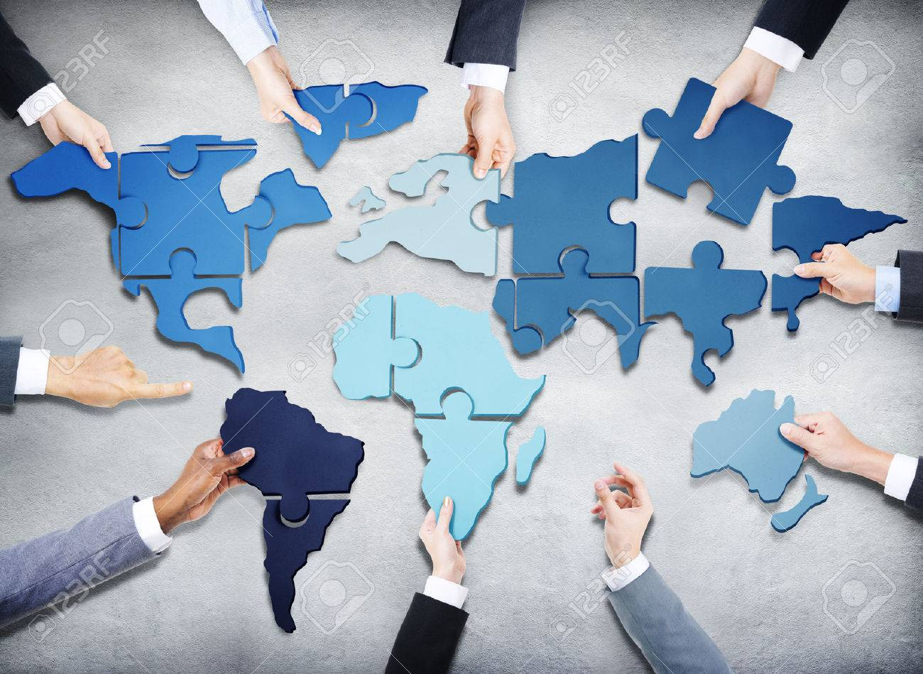 Group of business people with jigsaw puzzle forming in world stock group of business people with jigsaw puzzle forming in world map stock photo 34537347 gumiabroncs Gallery