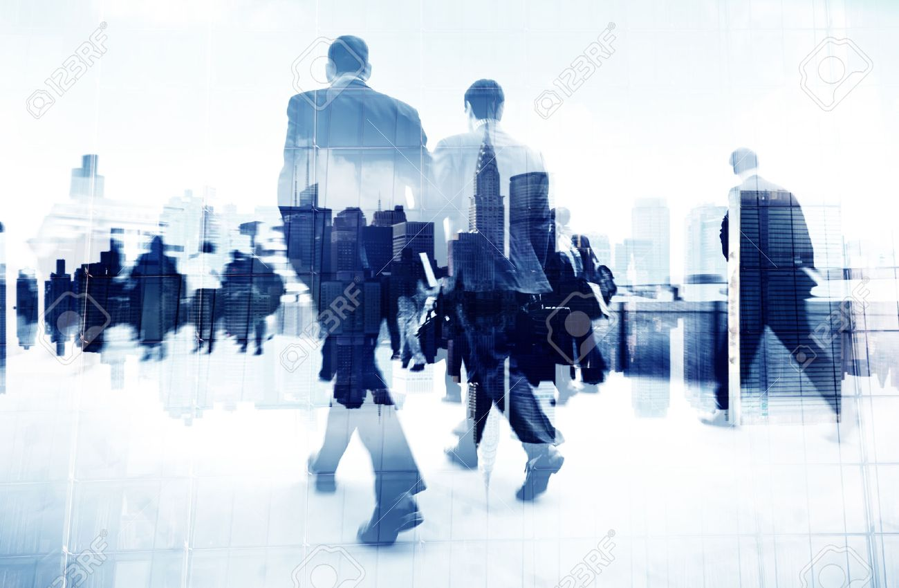 abstract image of business people walking on the street stock