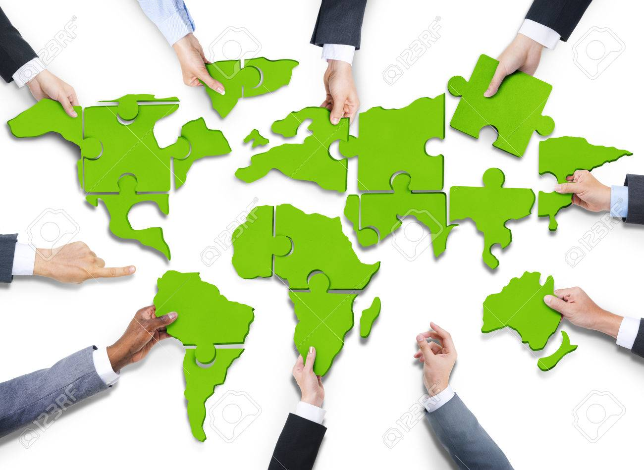 Group of business people with jigsaw puzzle forming in world stock group of business people with jigsaw puzzle forming in world map stock photo 35334269 gumiabroncs Image collections