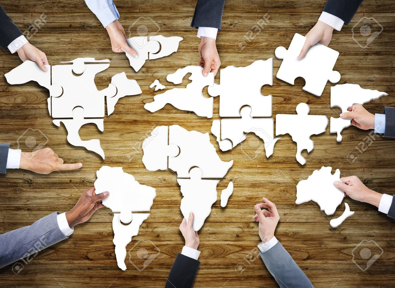 Group of business people with jigsaw puzzle forming in world stock group of business people with jigsaw puzzle forming in world map stock photo 35334340 gumiabroncs Gallery