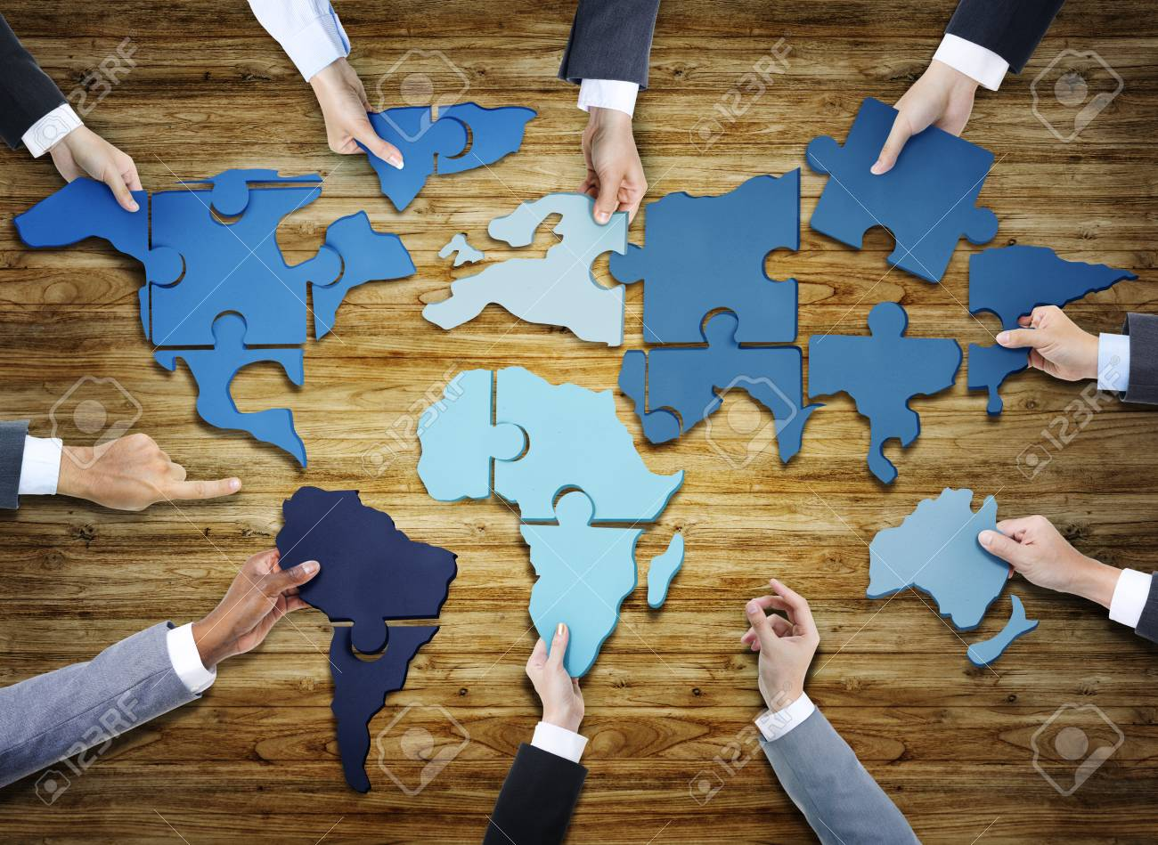 Group of business people with jigsaw puzzle forming in world stock group of business people with jigsaw puzzle forming in world map stock photo 35334342 gumiabroncs Image collections