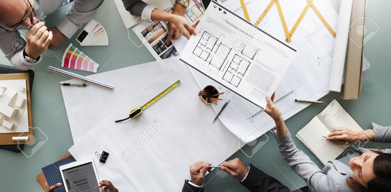 Business people planning blueprint architecture concept stock photo business people planning blueprint architecture concept stock photo 54625503 malvernweather Choice Image