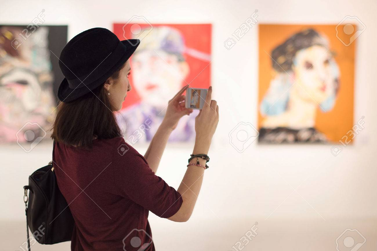 Woman Visiting Art Gallery Lifestyle Concept - 64140516
