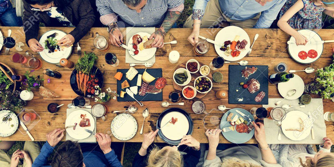 Group Of People Dining Concept Standard-Bild - 65165999