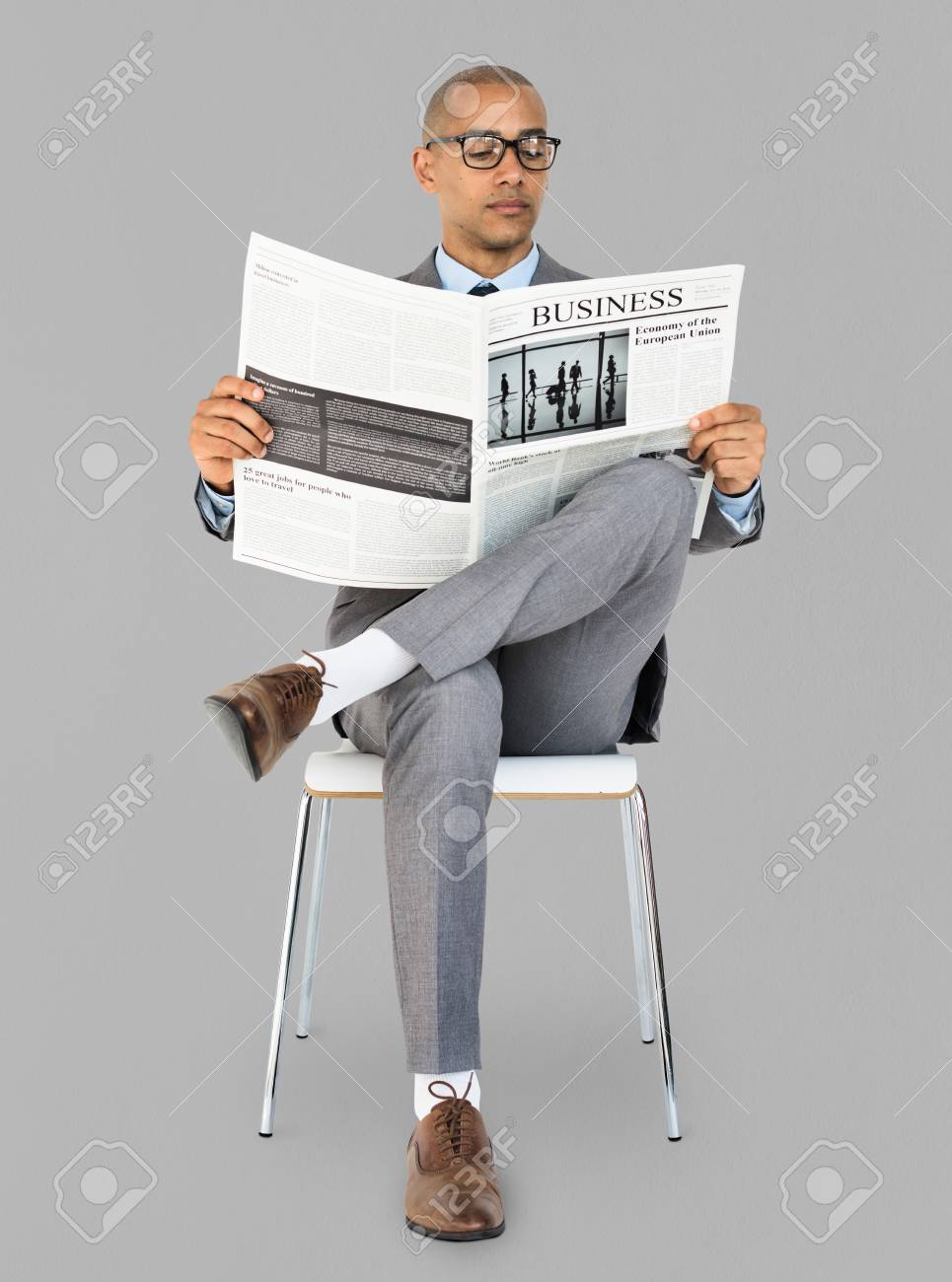 african descent business man reading newspaper stock photo, picture