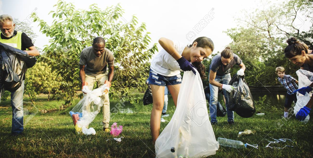 Diverse Group Of People Picking Up Trash In The Park Volunteer Munity Service Stock Photo