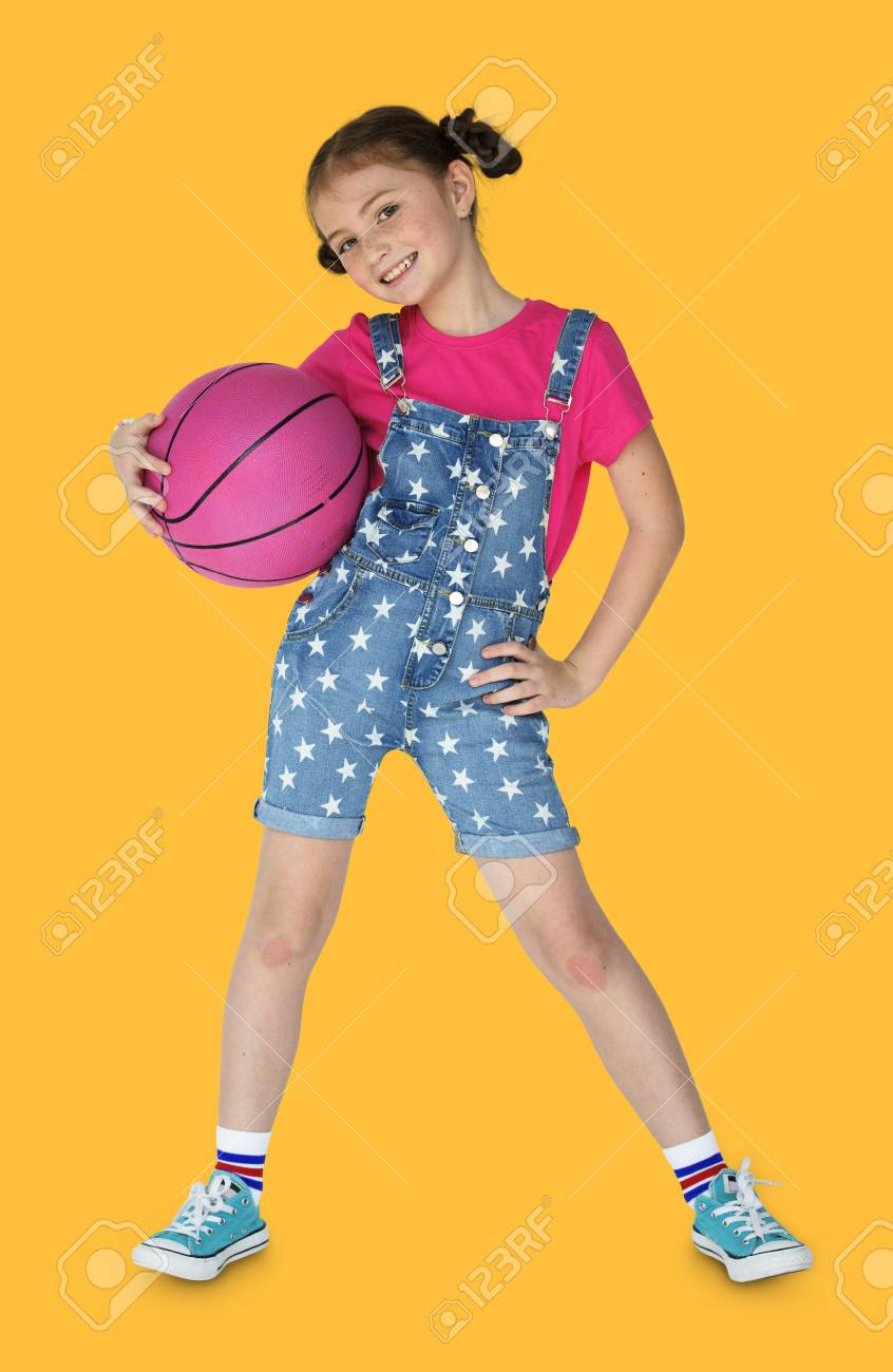 little girl holding basketball sporty smiling stock photo picture