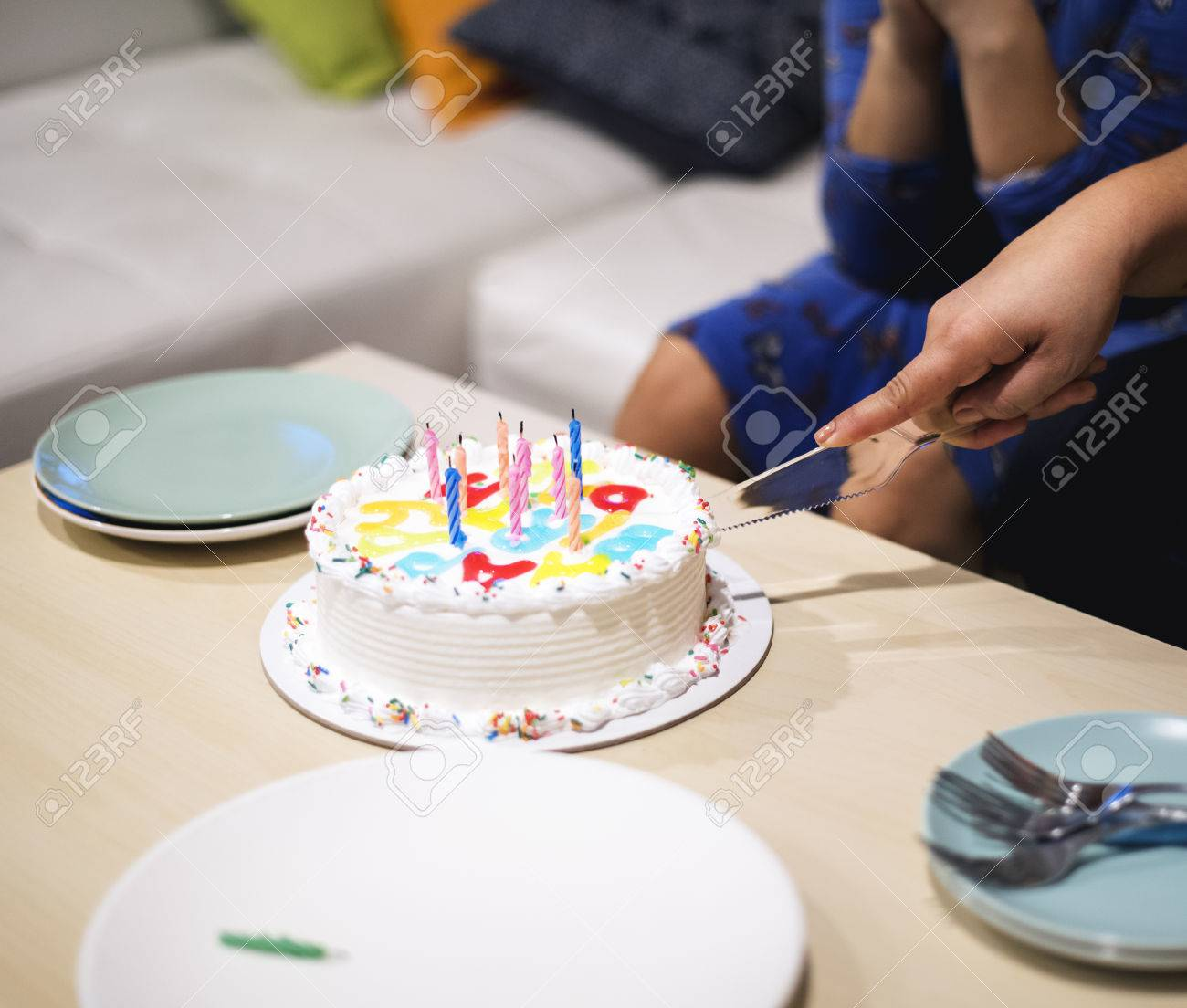 Hand Cutting Birthday Cake For Little Girl Stock Photo